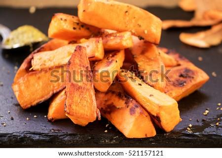 Sweet potato pieces on slate plate  #521157121