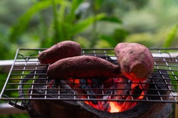 sweet potato roasted with charcoal on stove (selective focus)