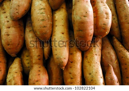 Sweet potatoes on display in the market.