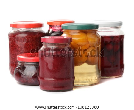 Sweet preserves as jams and compotes isolated on white - stock photo