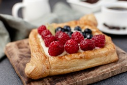 Sweet raspberry and cream, puff pastry dessert, diamond shaped.