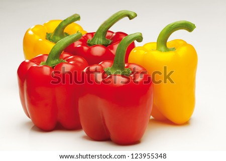 sweet red and yellow pepper on white background