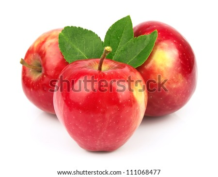Sweet red apples fruit with leafs on white closeup