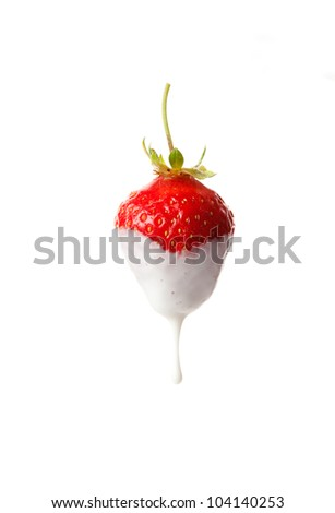sweet ripe strawberries with a drop of milk on a white background
