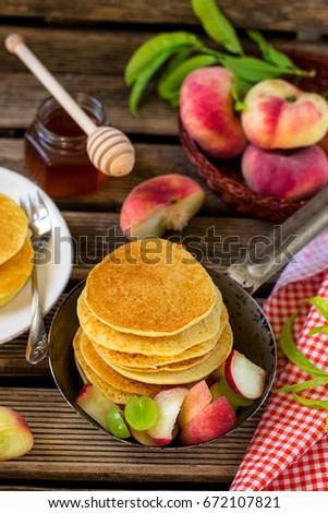 Sweet semolina pancakes with donut peaches and grapes #672107821