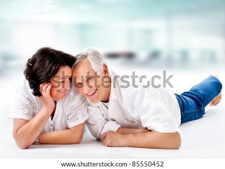 sweet senior couple on the floor with white background Сток-фото ©