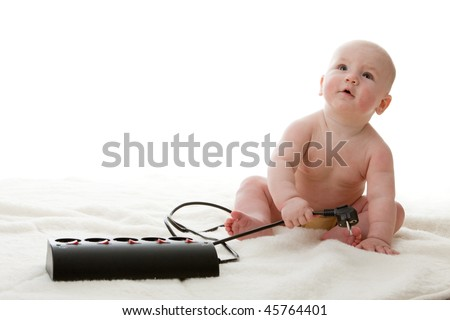 Sweet small baby with electric plug on a white background.
