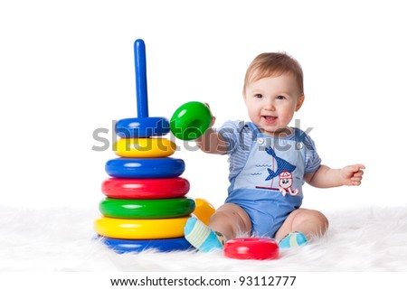 Sweet small baby with toy on a white background.
