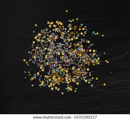 Sweet sprinkles mixture isolated on white background top view. Various sprinkle glaze decoration mix
