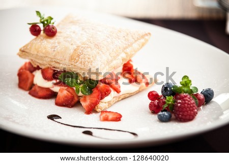 Sweet strudel with peach, strawberries and cottage cheese