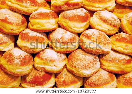 Sweet sugared creamy buns background