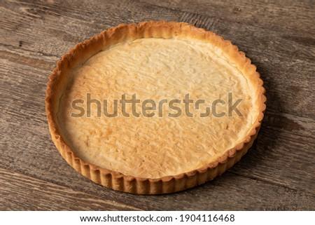 Sweet tart base on wooden table