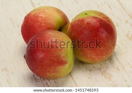Sweet tasty fresh ripe apricots over backround #1451748593