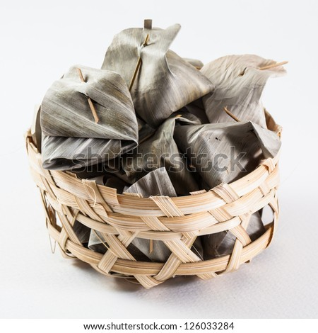Sweet Thai  traditional dessert cover with banana leaf in bamboo basket
