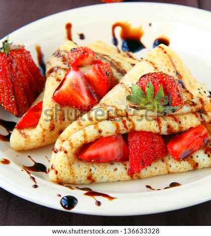 sweet thin french style crepes, served with strawberries