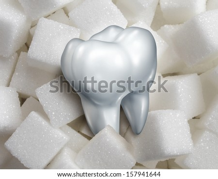 Sweet tooth dental health care concept as a single molar in a pile of sugar cubes as a health and diet symbol for craving sweetened foods that are bad for your health and diabetes risk.diabetes risk