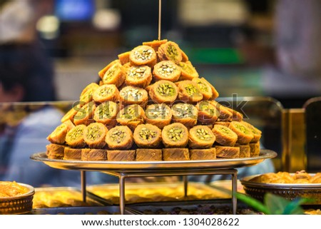 Sweet Turkish baklava dish on sale in food store in Istanbul.Sweet dessert pastry made of layers of filo filled with chopped nuts,sweetened and held together with syrup & honey