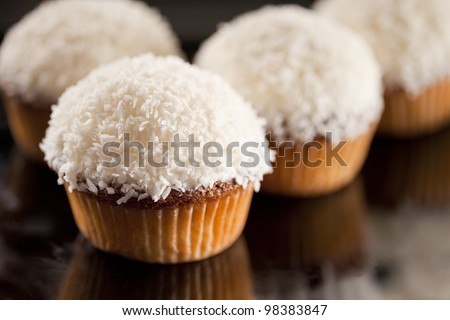 Sweet white cupcake with coconut and lemon