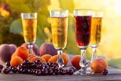 Sweet wine and fruits on  wooden table