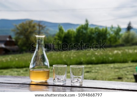 Sweet yellow honey wine meade in beautiful mountain landscape. Ready to drink.