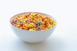 Sweetened Cereal fruit-flavored ring-shaped on a variety of bright colors and a blend of fruit flavors. Red, orange, yellow, green, blue and purple ring-shaped