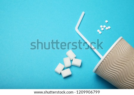 Sweetener pills, dispenser. Aspartame, sucralose, stevia rebaudiana. Copy space for text.