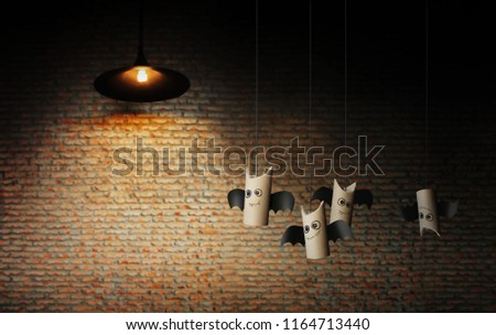 Stock Photo Sweetie bats of Halloween on brick wall. Halloween concept background.