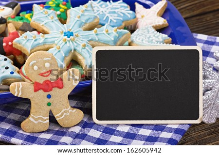 sweets and biscuits for Christmas and a blackboard with a greeting for the holiday