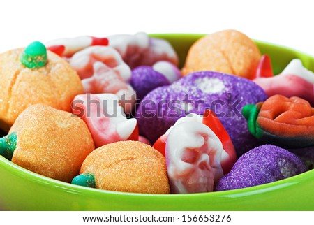 sweets and candies for the holiday halloween on a white background