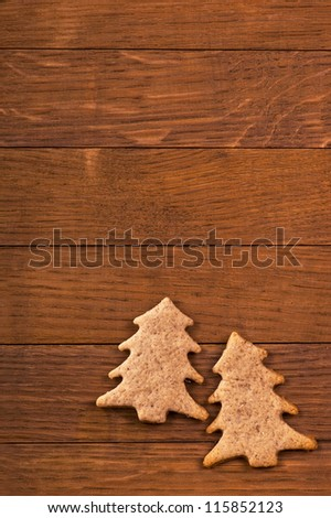 Sweets of handwork on wooden board  in the form of  fur-trees