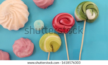 sweets on a blue background, marshmallows and caramel, caramel candies, homemade sweets, homemade caramel, homemade candies
