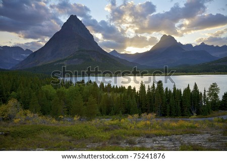 Swiftcurrent Lake and Mount Grinnell at Sunet, Glacier National Park, Montana, United States.
