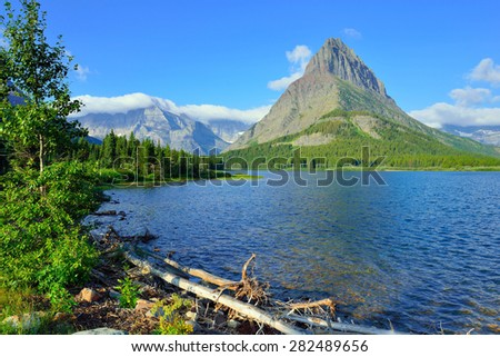 Swiftcurrent lake in high alpine landscape on the Grinnell Glacier trail, Glacier national park, Montana in summer