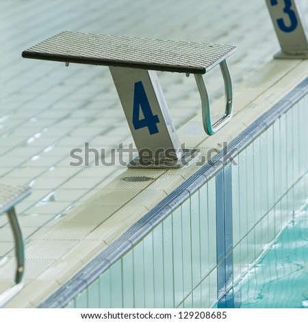 Swim race starting block and indoor pool, number 5