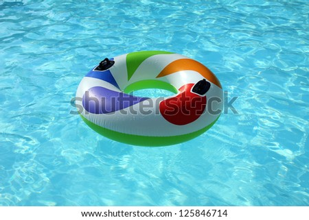 swim ring floating on a blue swimming pool