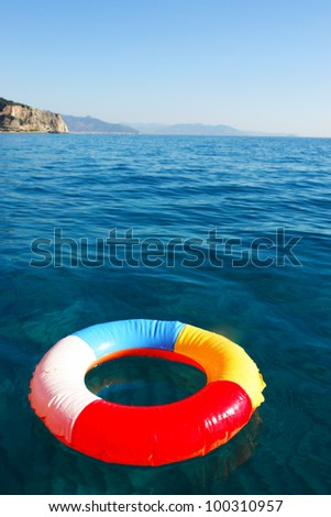 swim ring floating on beautiful blue water