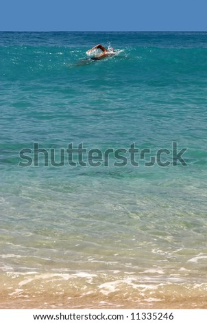 swimmer in a bay of St. Barth, Caribbean - stock photo
