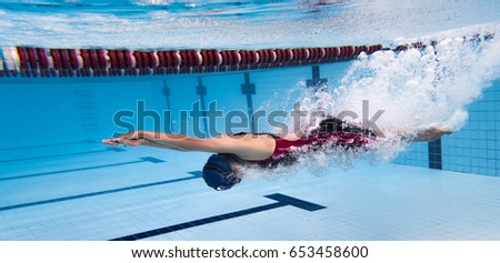 Swimmer woman Jump from platform jumping a swimming pool
