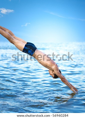 Stock Photo Swimmer jumping to sea water.