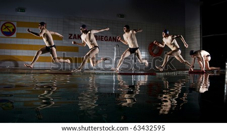 swimmer running on water on swimming pool