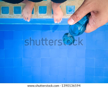 Boy with swim goggles swims in the swimming pool Images and ...