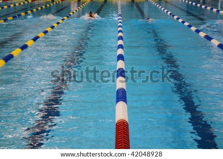 Swimmer swimming in butterfly stroke with goggles