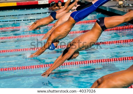 Swimmers and their competition in the pool - stock photo