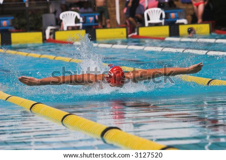 Swimming competition, man doing the butterfly stroke