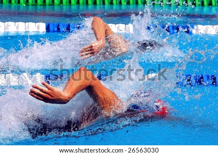 swimming, freestyle in waterpool with blue water - stock photo