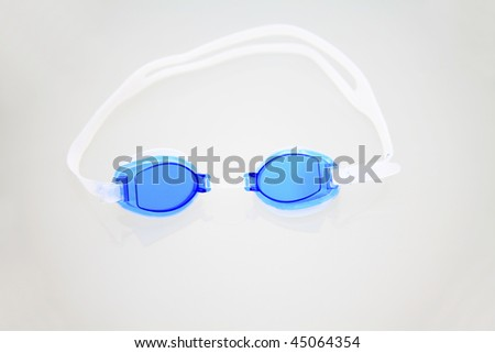 Swimming goggles isolated  on the white reflective background