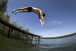 Swimming in the river. Diving from the bridge.