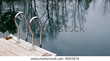 Swimming ladder on a small lake in winter