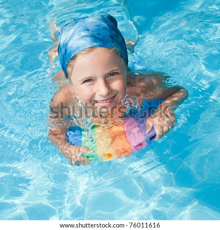 Swimming - little girl playing in blue water