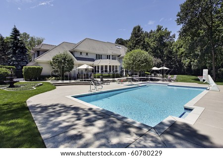 Swimming pool and deck in back of luxury home